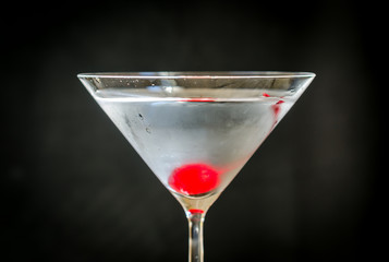 Martini cocktail with maraschino cherry