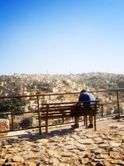 A man relaxing at view point of Amman Jordan