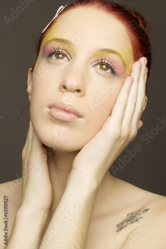 Close-up Portrait Of Woman With Creative Make-up