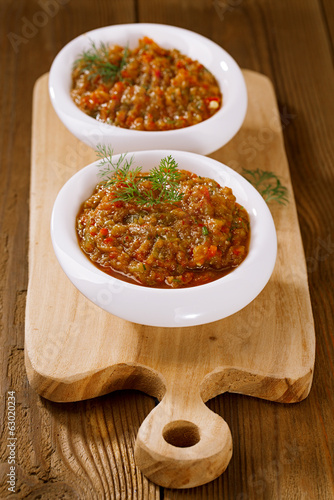 french aubergine eggplant caviar with oil  in white bowl on wood