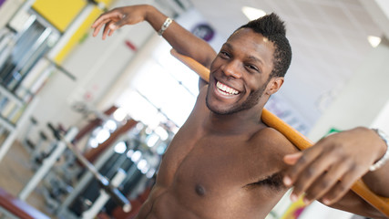 Smiling black man portrait in the gym.