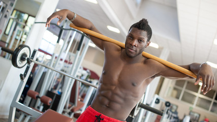 Strong black man exercising in the gym.