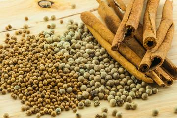 cinnamon rolls & pepper on wood background