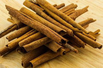 cinnamon rolls on wood background
