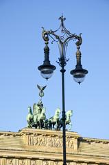 Brandenburg gate in Berlin and decorative lamp