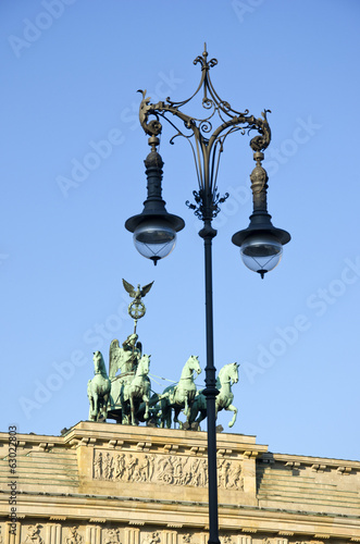 Brandenburg gate in Berlin and decorative lamp