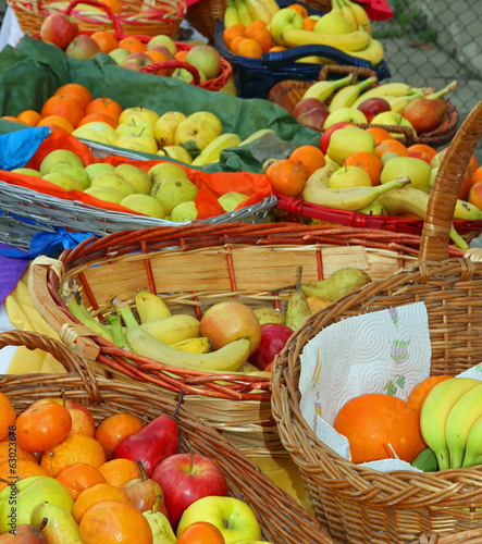 baskets filled with excellent fresh fruit with oranges