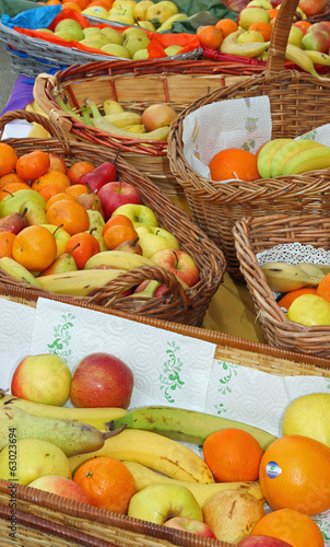 Wicker baskets filled with excellent fresh fruit with oranges