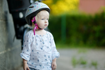 Little toddler girl ready to ride a bike