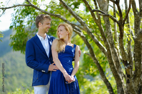 Young beautiful couple having fun in a park