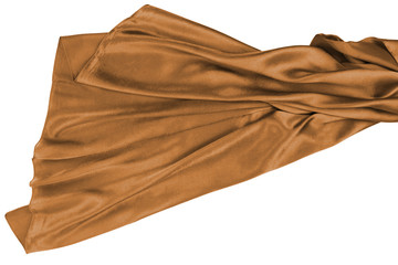 Brown rippling silk fabric on white background