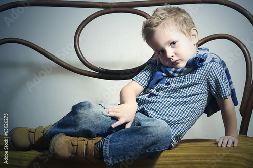 Child. Handsome little boy.Fashion Children.Vintage furniture