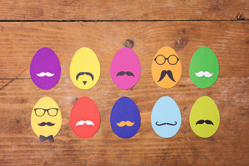 Colorful hipster Easter eggs on wooden surface