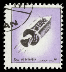 Stamp printed in emirate Ajman show spaceship, circa 1972