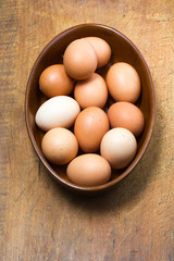 Organic, free-range eggs in terracotta bowl
