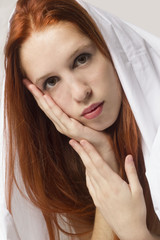 virginal red hair woman with hands in her face