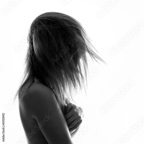 Isolated woman portrait in back light