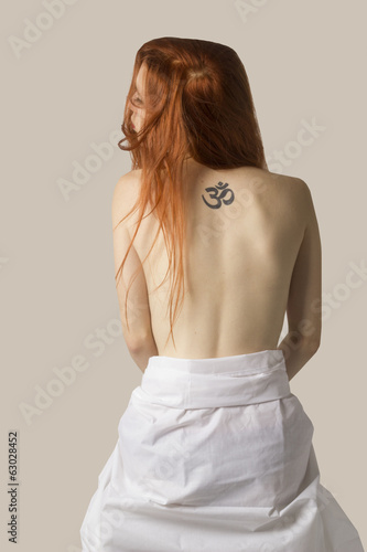 red hair woman with tattoo in her naked back