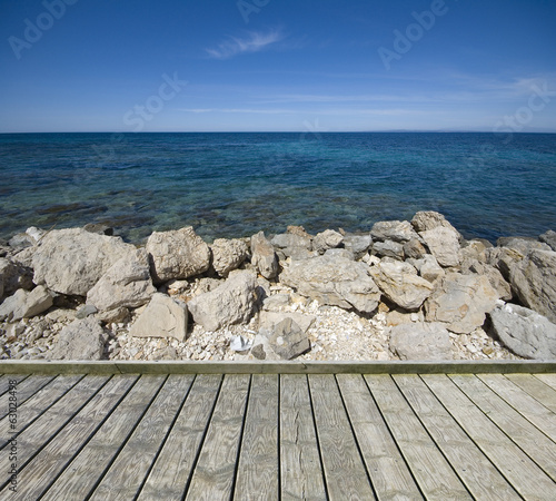 Jetty with stony coast of sea