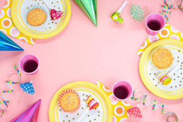 Girl birthday pink table setting with party gadgets