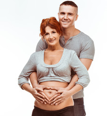 pregnant mother and happy father