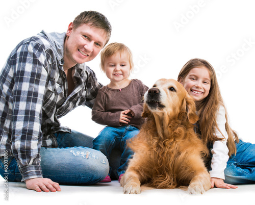 Dad and two daughters  with a dog