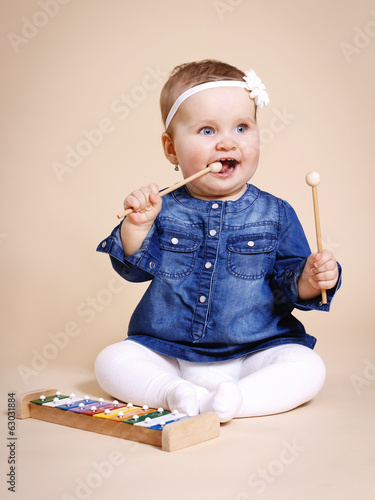 Little baby with xylophone
