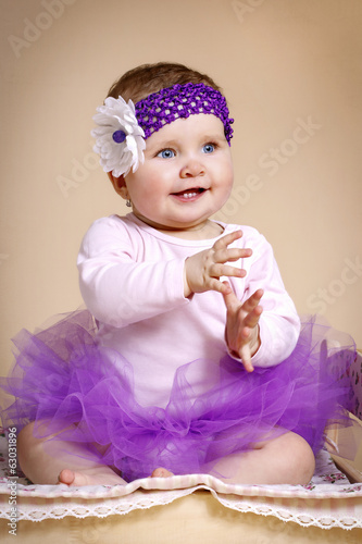 Beautiful baby girl with headband in tutu skirt