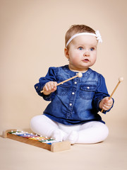 Little infant playing xylophone