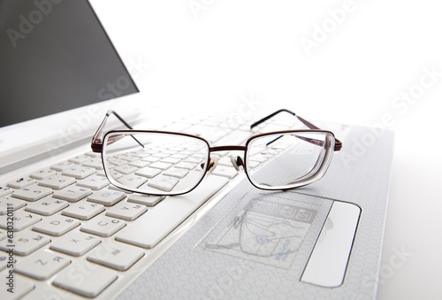 Eye glasses on a laptop keyboard