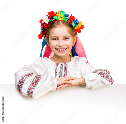 girl in  Ukrainian  costume behind white board