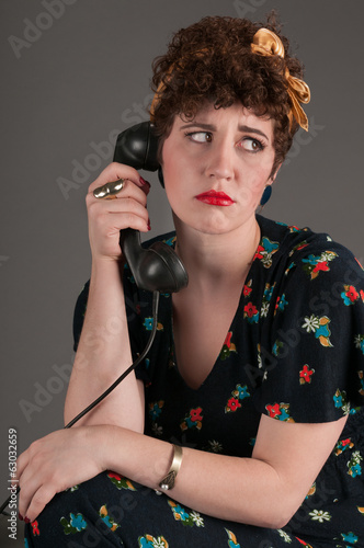 Pinup Girl Looks Upset by Phone News