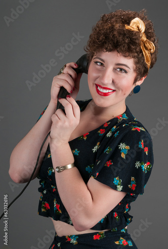 Pinup Girl Smiles While on Black Telephone