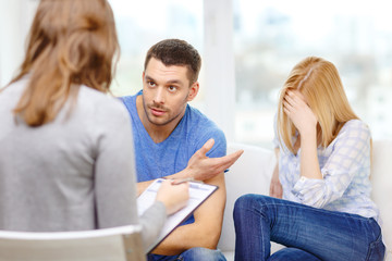 young couple with a problem at psychologist office