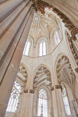 Batalha Monastery. Gothic style columns and ornate ceiling