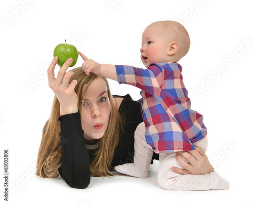mother and child baby boy kid with healthy green apple