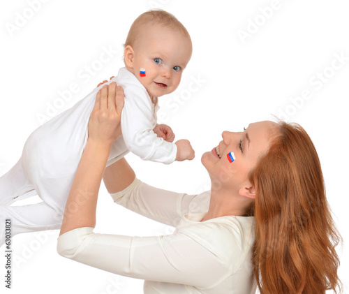 woman holding in her arms child baby kid girl with russian flag