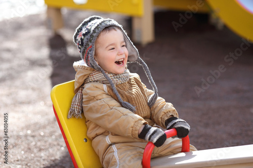 happy child on a swing on a sunny spring day