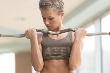 Beautiful Woman Working Out In A Health Club