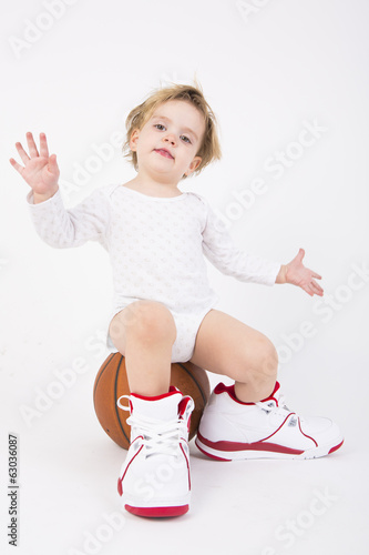 little girl with a basketball