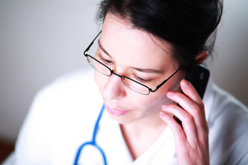 Portrait of female doctor phoning to focus on the eyes