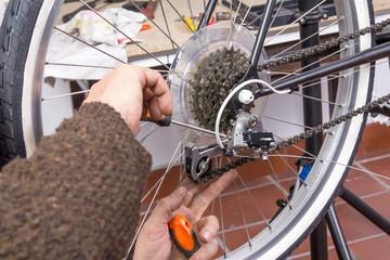 Real bicycle mechanic repairing custom fixie bike