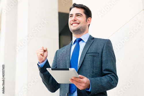 Confident Businessman using tablet computer
