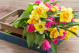 Fototapety bunch of spring flowers in wooden crate