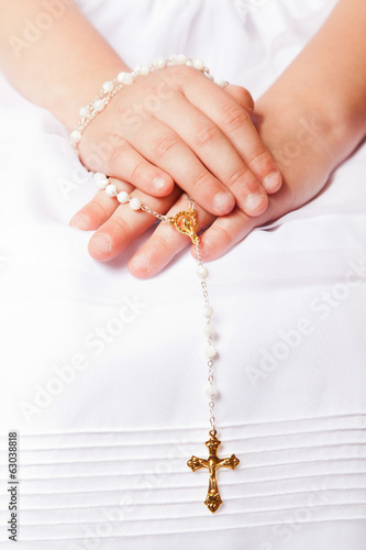 Hands of a little her in the First Communion Day