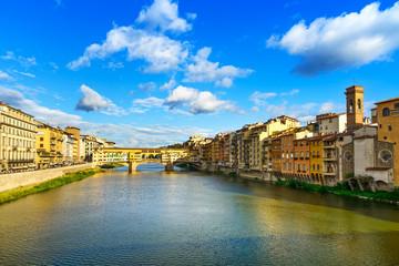 Ponte Vecchio landmark on sunset, old bridge, Arno river in Flor