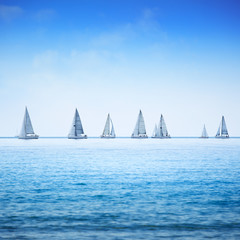 Sailing boat yacht regatta race on sea or ocean water