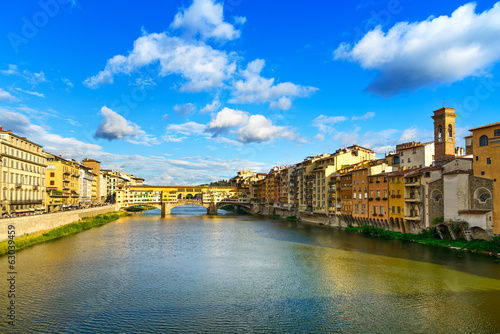 Ponte Vecchio landmark on sunset, old bridge, Arno river in Flor
