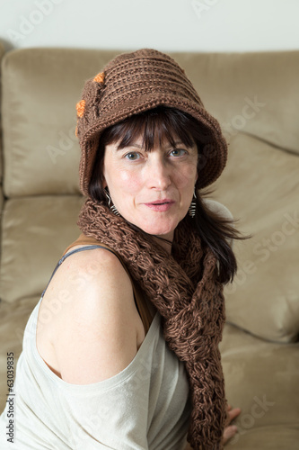 woman sitting on a sofa looking at camera