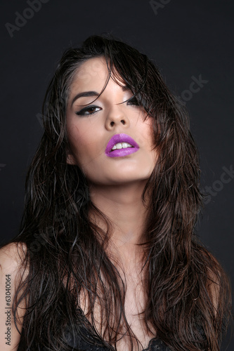 Sultry Young Woman on a Simple Background